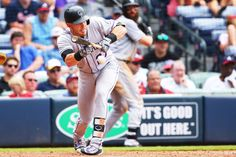 Story book bunt:    Trevor Story #27 of the Colorado Rockies bunts against the Atlanta Braves in the ninth inning at Turner Field on July 17, in Atlanta, Georgia. He was thrown out at first. Atlanta won 1-0.