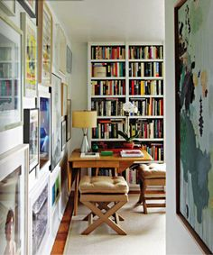 Source Unknown {white classic traditional vintage modern library / study with lots of art} by recent settlers, via Flickr