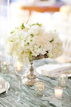 Classic white wedding centerpiece {Photo by KT Merry via Project Wedding}