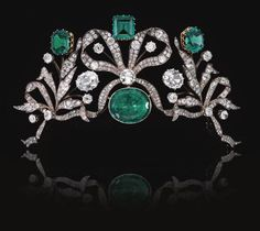 This emerald and diamond tiara, c. 1870, was formerly the property of a Belgian Princess. The octagonal, step-cut, and hexoganal emeralds at the top weigh 7.58, 7.26 and 8.05 carats, respectively. The two diamonds around the larger center emerald are 2.93 and 3.85 carats, respectively. The tiara is designed as series of bows entwined with foliate sprays.