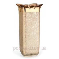 Керамическая ваза Eterna SD476-S. Цвет вазы – золотой глянец с узором. Эта ваза особенно хорошо впишется в интерьер, в котором используются золотистые мотивы, например, текстиль (шторы, подушки), или большое зеркало с золотистым обрамлением…   Размер вазы 13.5x13.5x30.5 см.