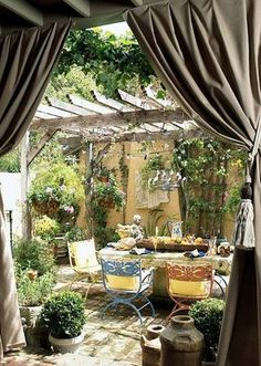 Set up your patio like you are preparing for a play and outdoor entertaining will never be a big production.  Using outdoor curtains to frame the entrance to your deck or patio creates instant drama.  Lighting always helps set the mood. String lights from a pergola and add candles for accents.  Decorate from the floor to the ceiling for maximum impact. And remember, outdoors the sky is the limit!  Colorful furniture draws your guests to the table.