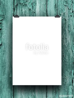 Blank frame hanged by clips against aqua weathered wooden boards background
