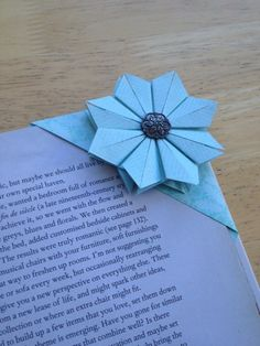 Origami bookmark. This is good for all those book lovers. I want to make this!!!!!!