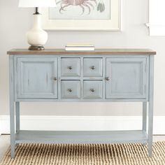 This Brighton side board features a regal French blue finish. Four drawers, two doors and a shelf add practicality to this handsome side board.