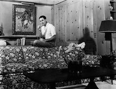 Errol Flynn Homes | Errol Flynn is his living room at Mulholland Farm.