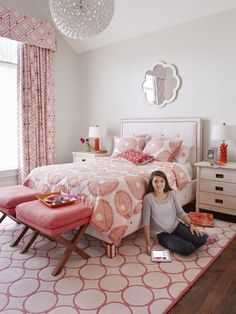 A competitive swimmer who's often up at 4:30 a.m. for practice, Grace, 15, has a first-floor bedroom so she won't wake her sisters. Since she loves orange and pink, they pop up all over the room, and a variety of shapes make the space even more fun. There's a circle print on the rug and bedding, a diamond pattern on the curtains, and a flower-like mirror.