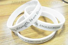 Use white color wristbands to support various awareness and causes like brain injury, prevent violence against women, rare disease awareness and much more. Artwork Online, Rare Disease, Wishes Messages, Trigeminal Neuralgia, Wedding Rings, Lung Cancer, Brain Injury, Engagement Rings, Band