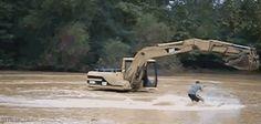 Excavator waterskiing
