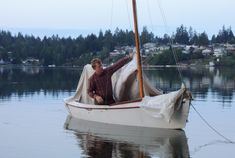 """"""" A canvas painter's dropcloth made a simple, but effective cockpit tent"""" for this Blue Jay sailing along the Cascadia Marine Trail"""