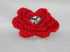 Red flower with heart shaped button. Add to you favorite headband or hat.