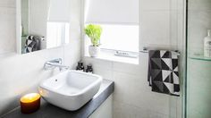 Caro and Kingi's ensuite featured some black, whites and a little grey with our Evolution White and Evolution Grey tiles.