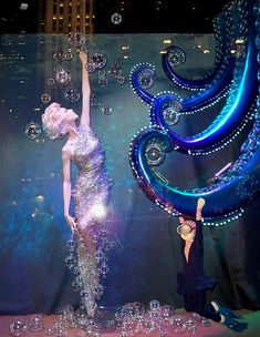 """Beautiful display window with glass bauble """"bubbles"""" and lit octopus"""