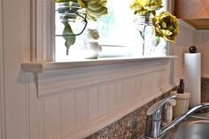 beadboard backsplash - I've never considered using this as a back splash before but it would lighten up my kitchen and be cheap and easy to do!