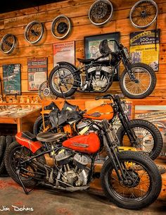 """""""Historic Dirt Trackers"""". The second floor mezzanine at Wheels Through Time displays dozens of historic racing machines, including various national champions and Daytona winners. Pictured are three original 1940s Harley-Davidson WRs, the company's top factory racing model during the era."""
