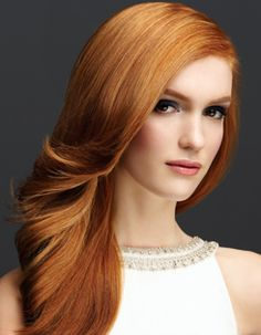Love the color and smooth flowing waves in this hairstyle.