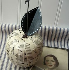 Dishfunctional Designs: Upcycled Sheet Music Crafts--there are several great ideas on this blog