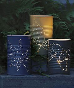 Tin Can Luminaries. Worked real well. Next time I make them, I will spray paint after the holes are in. I used hemp rope not wire for the handle and the flame less tea light.