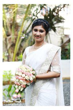 Adorable bride in white saree - feathertouch beauty salon, pathanamthitta