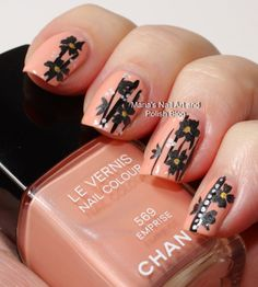 Black flowers on Emprise - nail art