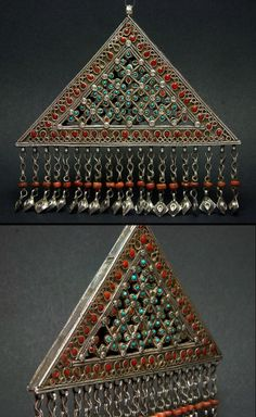 Afghanistan | Old silver triangular pendant; possibly from the province of Nooristan | Refined silver openwork, with turquoise and coral like cabochons | 450€