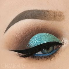 WEBSTA @ cinda.beauty - Minty Turquoise Half Cut-Crease Makeup Look with a loooot of Glitter BROWS@anastasiabeverlyhills @norvina #DipBrow Pomade in 'Taupe' Tinted Brow Gel in 'Granite'@sigmabeauty Brow Powder Duo in Medium LASHES@lotuslashesofficial in '501' EYES@anastasiabeverlyhills #abhshadows in 'Aqua' @tartecosmetics Tarteist Clay Paint Liner@makeupgeekcosmetics in 'Poolside'@morphebrushes 35O Palette @saturated_colour Multitasker Pencil in 'Greek Blue' (waterline)BRUSHES#Sigm...