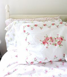 Gorgeous vintage textiles. - I miss the pretty floral on white sheets from many years ago. These are lovely.