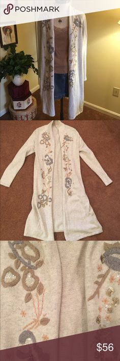 ❣️NEW❣️Chicos Duster Length Sweater Beautiful light gray colored long Duster sweater by Chicos. Size 1 (8/10). Beautiful crewel embroidery with sequins adorn both sides along the front. This is new without tags! Would look amazing with skinny jeans and booties!! Chicos Sweaters Cardigans