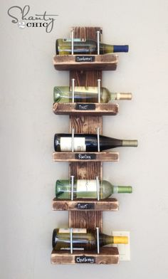 ~ Shanty 2 Chic Wine Rack ~ {I'm using as 2 ltr drink bottle holder} MATERIALS:  > 1 - 2×6 cut at 38″ > 5 – 2×4 cut at 10″ > 10 – 5/16 x 4 1/2″ hex bolts (we found ours on the hardware aisle for $.38 a piece) > 10 – 2 1/2″ wood screws > wood glue > finishing supplies DIRECTIONS:  1. started by marking our 2×6 board.  We lined up our 2×4 piece every 6″ and marked lines on the bottom and top of the 2×4.  We did this to both sides of the 2×6 board.