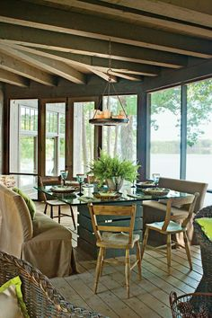 Natural Furniture - Naturally Inspired Georgia Lake House - Southernliving. The outdoor dining table's pedestal is made from crating material.    Source Guide Dining benches: custom by Century Upholstery, Atlanta