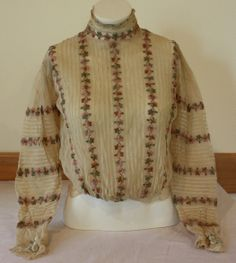 """This Blouse was donated by Mary Divok. It's an Ecru Sheer Netting Blouse. It Has a Choker Collar, Bishop Sleeve With Stripes of Flower Embroidery. Arm Holes and Waist Have Elastic.  Tag Inside Says """"THE LADIVEAR BRAND"""" Size 38. Bishop Sleeve, Flower Embroidery, Arm, Chokers, Men Sweater, Beautiful Women, Stripes, Blouse, Womens Fashion"""