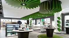 Swirling acoustic baffles quiet a new Telus Communications 'connected experience' store by DesignStead. #filzfelt #woolfelt #acousticbaffles