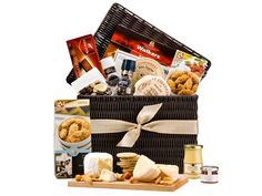 A luxurious wicker hamper for friends, relatives or colleagues, combining 3 cheeses, biscuits, nuts mustard, chocolates and much more