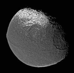 Saturn's Moon Iapetus has a unique feature which was, until recently, a complete mystery. Running along its equator is this weird ridge of mountains. The mountains run exactly along the equator, are perfectly straight, and—so far—...