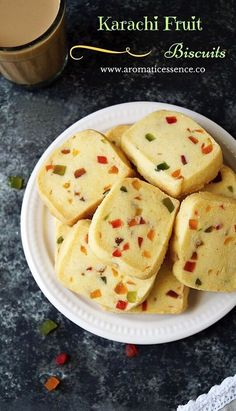 Karachi biscuits are popular Indian tea time cookies. These egg-free fruit biscuits have derived their name from the famous 'Karachi bakery' in Hyderabad, India. They are sweet, crumbly, melt in the mouth, studded with candied fruits and flavored with two Indian Desserts, Indian Sweets, Indian Snacks, Indian Food Recipes, Fruit Biscuits, Biscuit Cookies, Biscuit Recipe, Tutti Frutti, Eggless Baking