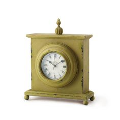 a shabby cottage chic style iron clock features chippy chartreuse colored paint it is a