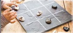 Tic-Tac-Toe Keep this naturally beautiful game board at the ready for family fun. A piece of slate, chalk, permanent marker/paint pens and stones! Lowescreative
