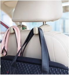 Hooks that attach to a car's headrest. Finally a place to hang your purse.