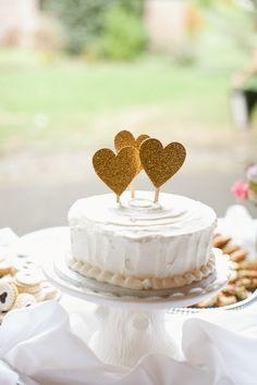gold glitter heart cake toppers // photo by Caitlin Thomas // http://ruffledblog.com/whimsical-pennsylvania-wedding