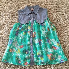 Chambray floral sheer top Upper is chambray denim and bottom is sheer polyester floral print. Button front. Faux pockets. Looks brand new. Juniors XL. Note: I'm selling for a friend who is a cat owner . Canyon River Blues Tops Blouses