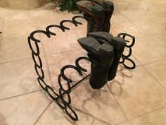 This bout rack can hold up to 6 pairs of boots . It holds boot upside down.it is made from used lucky horse shoes. Can be made to order in any