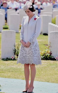 """"""" The Duchess stood in silence for a moment as she honoured the memories of the thousands of Commonwealth soldiers killed in battle at The Tyne Cot Commonwealth War Graves Cemetery in Zonnebeke on..."""