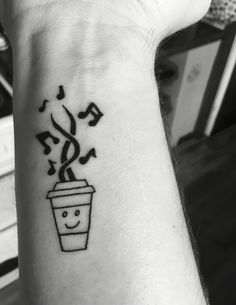One of my first Tattoos. My own sketch. Combining my love of coffee and music with a tiny bit of Lego.