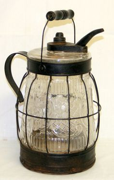 1860's oil jug w/wire frame   I have to find my old oil jug to use in my new summer kitchen(craft room)
