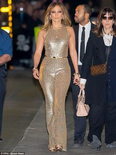 Jennifer Lopez wearing Valentino My Rockstud Mini Top-Handle Tote Bag and Michael Kors Gold Embellished Jumpsuit Sparkly Jumpsuit, Gold Jumpsuit, Embellished Jumpsuit, J Lo Fashion, Star Fashion, Jennifer Lopez News, Metallic Jumpsuits, Vestidos Sexy, Michael Kors Gold