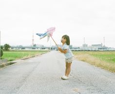 A Girl And Her Imagination:Nagano Toyokazu photographs his daughter, Kanna, on the same road in a variety of situations.