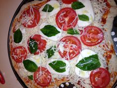 Home made Pizza with basil, heirloom tomatoes and fresh mozzarella. Made with daddy love.