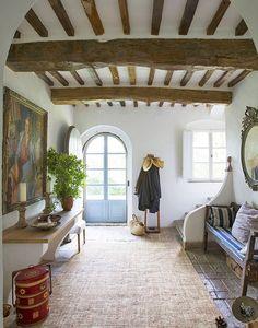 Hessian rug, rustic floor tiles, green plant, tradition door
