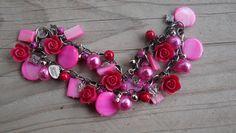 Armband van roze kralen www.leeuw-design.nl