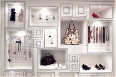 "Loving the black-&-white, ""created local"" look of this display wall. Would this be great or what for your designer bags, high-end footwear in your consignment or resale shop? http://TGtbT.com"